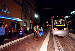 Metro light rail train running down Main Street in downtown Houston