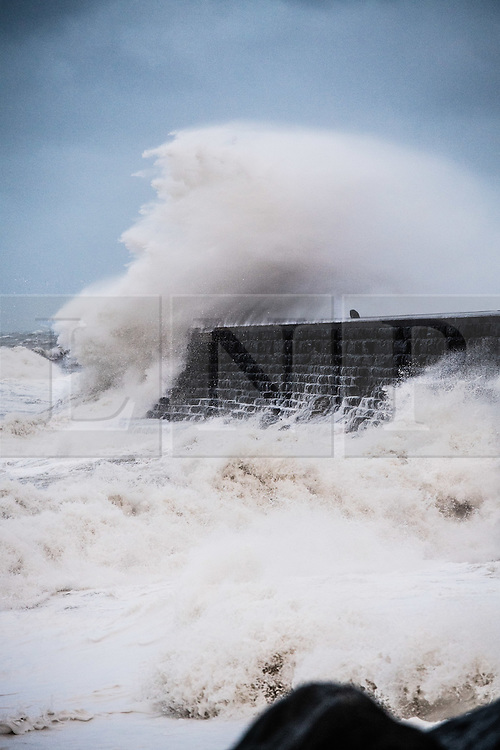 &copy; London News Pictures. 23/02/2017. Aberystwyth,UK. In the early hours of Thursday morning, Storm Doris, the fourth named storm of the winter, hits the seaside town of Aberystwyth, bringing massive waves pounding against the promenade and sea defences. Violent Storm Force 11 winds, with gusts of  of up to 90mph are forecast for part of North Wales and NorthWest England, with the risk of damage to property and severe disruption t travel<br /> Photo credit: Keith Morris/LNP