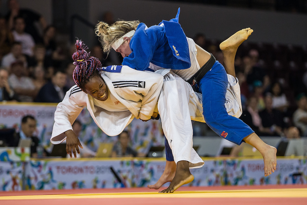Hannah Martin (Top) of the United States  is thrown by Maylin Del Toro of Cuba during the bronze medal contest in the women's judo -63kg class at the 2015 Pan American Games in Toronto, Canada, July 13,  2015.  AFP PHOTO/GEOFF ROBINS