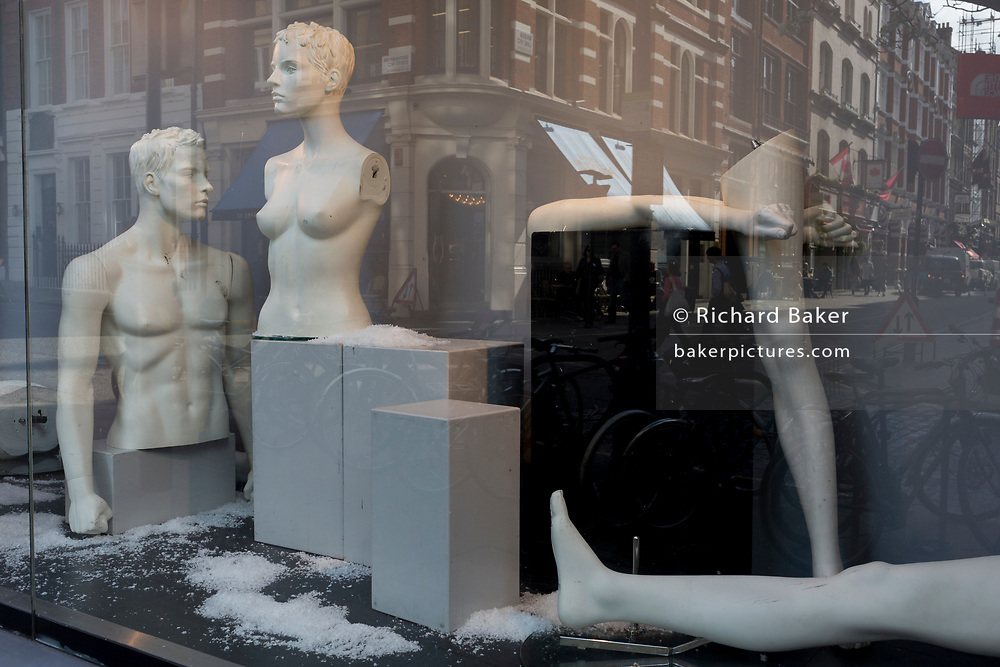 Disjointed mannequins in the window of an outdoor retailer, on 28th March, 2017, in London, England.