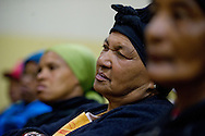 MANENBERG, SOUTH AFRICA - SEPTEMBER 12: Community members gather to plan a protest of rising electricity prices at the Manenberg People Center on September 12, 2013 in Manenberg, a township of Cape Town, South Africa. Members of the community were hesitant to gather after dark at the center after gang related shooting occurred a week prior across the street from the Manenberg People Center. Photo by Ann Hermes/The Christian Science Monitor