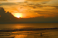 A wonderful golden sunset over the sea at Seminyak in Bali, Indonesia.