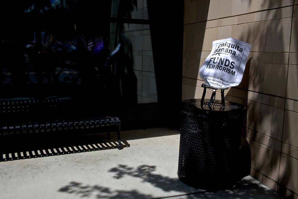 A protest sign rests on a trash can two days before the 2012 Democratic National Convention in Charlotte, N.C. on Sept. 2, 2012.