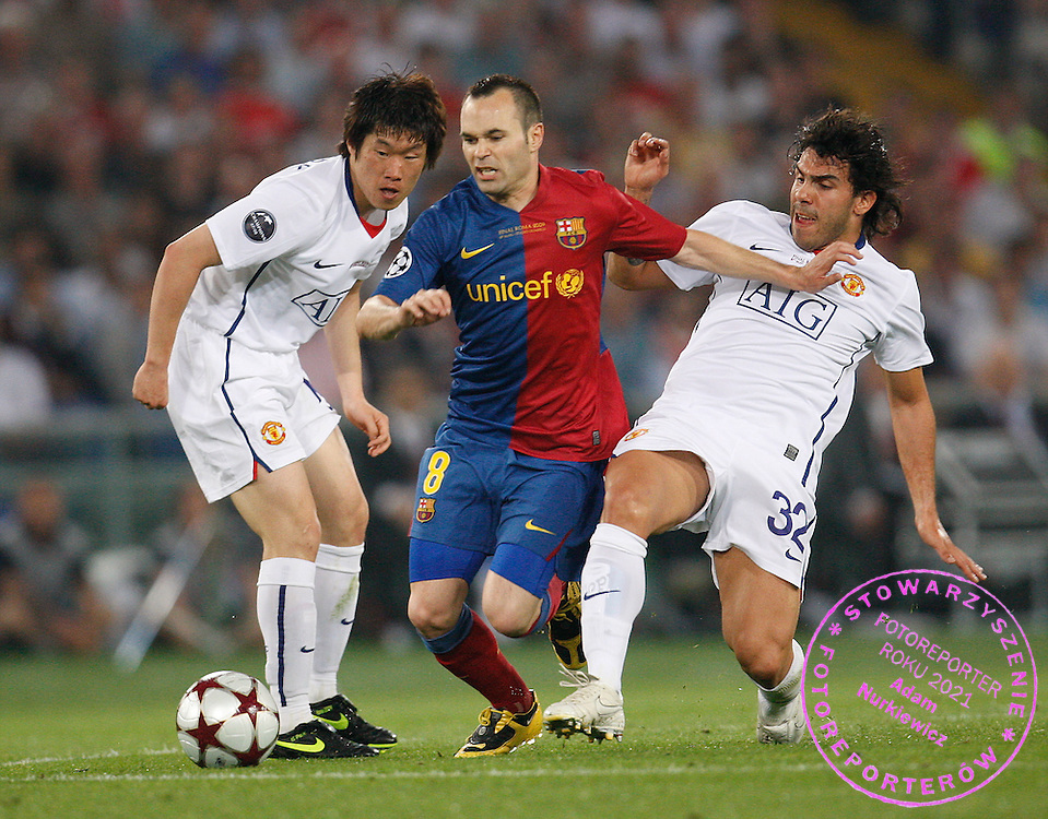 ROME 27/05/2009.Uefa Champions League - Final.Manchester United v Fc Barcelona.Andres Iniesta of Barcelona is fouled by Carlos Tevez of Manchester United ..Fot. Piotr Hawalej / WROFOTO