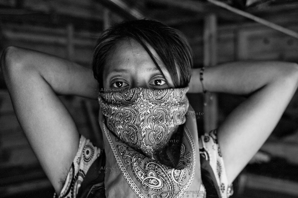 Zapatist woman wearing her shawl.<br /> Mujer zapatista llevando su pa&ntilde;uelo.