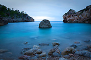 "Evening blues at Cala Deia, Mallorca, Balearic Islands. It was at this rocky inlet that Anais Nin based her erotic short story, ""Mallorca""."