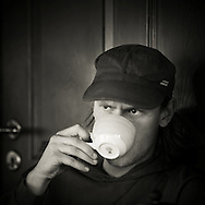 Man drinking coffee at Prikið cafe in Reykjavik Iceland