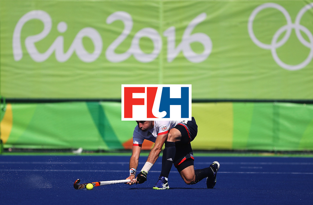 RIO DE JANEIRO, BRAZIL - AUGUST 06:  Iain Lewers #24 of Great Britain  passes during a Pool A match between Belgium and Great Britain on Day 1 of the Rio 2016 Olympic Games at the Olympic Hockey Centre on August 6, 2016 in Rio de Janeiro, Brazil.  (Photo by Sean M. Haffey/Getty Images)