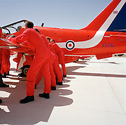 Pilots of the Red Arrows, Britain's RAF aerobatic team during pre-display briefing on a Hawk wing before an airshow.