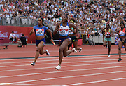 Jul 20, 2019; London, United Kingdom; Shelly-Ann Fraser-Pryce (JAM) defeats Daryll Neita  (GBR) on the anchor of the women's 400m relay, 42.29 to 42.30, during the London Anniversary Games at London Stadium at  Queen Elizabeth Olympic Park.