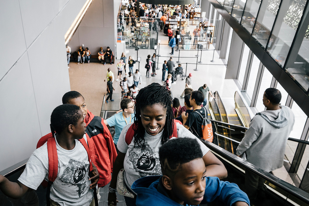 Sixth-graders from Knowledge Is Power Program (KIPP) DC, including Tay'sean Barrow, 12, left, Tyrone Proctor, 11, right, and teacher Gabrielle Randall, take the escalator to the third floor inside the Smithsonian National Musuem of African American History and Culture during their visit on Oct 21, 2016. The students spent an hour touring the new Washington, D.C. museum, which is only available to see with reserved tickets during the first year.