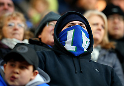 Wigan Athletic fan covers his face with his scarf to keep warm at a cold DW Stadium - Mandatory by-line: Robbie Stephenson/JMP - 24/02/2018 - FOOTBALL - DW Stadium - Wigan, England - Wigan Athletic v Rochdale - Sky Bet League One