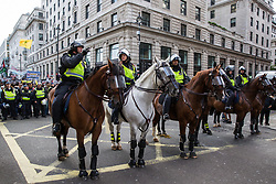 London, UK. 10th June, 2018. Metropolitan Police officers in riot gear are deployed at the front of the pro-Palestinian Al Quds Day march through central London organised by the Islamic Human Rights Commission. An international event, it began in Iran in 1979. Quds is the Arabic name for Jerusalem.