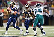ST. LOUIS, MO - SEPTEMBER 11:   Rodger Saffoid #76 of the St. Louis Rams drops back to pass block against Trent Cole #58 of the Philadelphia Eagles at the Edward Jones Dome on September 11, 2011 in St. Louis, Missouri.  The Eagles defeated the Rams 31 to 13.  (Photo by Wesley Hitt/Getty Images) *** Local Caption *** Rodger Saffoid