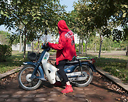 A youngster Vietnamese poses with his motorbike in a park close from Vinhomes Riverside, Hanoi, Vietnam, Southeast Asia