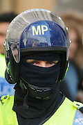 A police man wearing protection