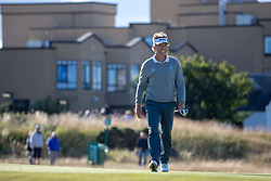 Bernhard Langer celebrates after holing his putt for birdie on the 17th hole during day three of the Senior Open at Old Course St Andrews.