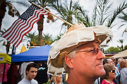 22 OCTOBER 2010 - PHOENIX, AZ:  A man with Tea Bags on his hat at a Tea Party rally in Phoenix, AZ, Friday. About 300 people attended a Tea Party rally on the lawn of the Arizona State Capitol in Phoenix Friday. They demanded lower taxes, less government spending, repeal of the health care reform bill, and strengthening of the US side of the US - Mexican border. They listened to Arizona politicians and applauded wildly when former Alaska Governor Sarah Palin and her son, Trig, made a surprise appearance. The event was a part of the Tea Party Express bus tour that is crossing the United States.     Photo by Jack Kurtz