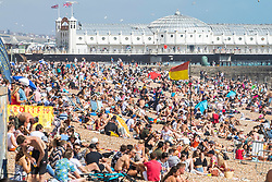 © Licensed to London News Pictures. 01/08/2020. Brighton, UK. Thousands of people take to the beach in Brighton and Hove as sunny weather hits the seaside resort. Photo credit: Hugo Michiels/LNP