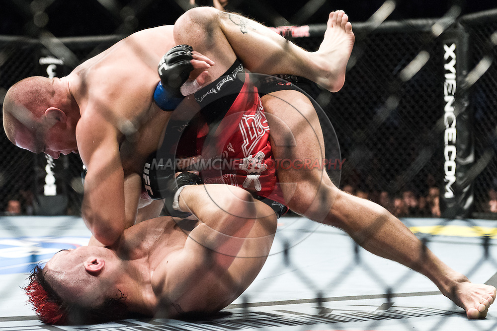 "NEWARK, NEW JERSEY, MARCH 27, 2010: Georges St. Pierre (top) and Dan Hardy are pictured during their bout at ""UFC 111: St. Pierre vs. Hardy"" in the Prudential Center, New Jersey on March 27, 2010"