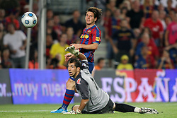 FC Barcelona's Leo Messi (t) and Athletic de Bilbao's Gorka Iraizoz (d) during the Supercup of Spain.August 23 2009.