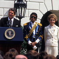"Michael Jackson is welcomed at the White House in May 1984 by President Ronald Reagan and Nancy Reagan. Jackson received a commendation for his work against teenage drunk driving. ""Isn't this a thriller?"" President Reagan commented."
