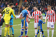 Opening handshakes during the The FA Cup 3rd round match between Shrewsbury Town and Stoke City at Greenhous Meadow, Shrewsbury, England on 5 January 2019.