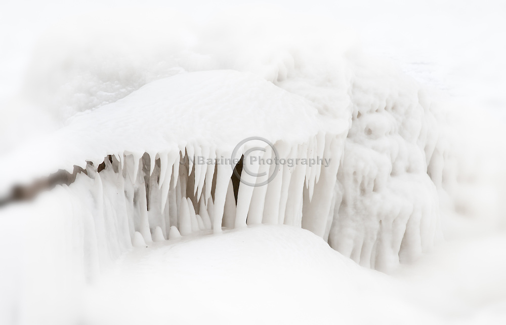 Frozen water builds an ice shelf over a breakwater on the shores of Lake Erie, Ontario