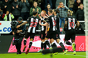 Matthew Longstaff (#43) of Newcastle United celebrates Newcastle United's first goal (1-0) with Newcastle United team mates during the Premier League match between Newcastle United and Manchester United at St. James's Park, Newcastle, England on 6 October 2019.