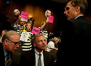 Apr 27,2010 - Washington, District of Columbia USA - .Protesters express their contempt for the current and former Goldman Sachs executives as David Viniar, Executive Vice President & Chief Financial Officer of Goldman Sachs, consults with his attorneys  during Tuesday's hearing. Goldman Sachs executives were appearing before the Senate Homeland Security and Governmental Affairs subcommittee Hearing on Wall Street and the Financial Crisis. (Credit Image: © Pete Marovich Images)