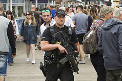 May 28, 2017 - Brighton, East Sussex, United Kingdom - Brighton, UK. Armed officers of the Brighton and Hove police force patrol the Brighton Palace Pier. Police have increased the number of armed officers on the street in the aftermath of the Manchester Bombing. (Credit Image: © Hugo Michiels/London News Pictures via ZUMA Wire)