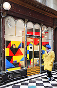 Brightly coloured modernist shop window display in the Galerie Vero-Dodat, covered shopping arcade built 1826 between the Rue de Jean-Jacques Rousseau and Rue de Croix-des-Petits-Champs, 1st arrondissement, Paris, France. The arcade is Neoclassical in style, with a tiled floor and wooden shop fronts. It was restored in 1997 and is listed as a historic monument. Picture by Manuel Cohen