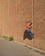 Doug Ayers buildering the climbing gym in Colorado Springs