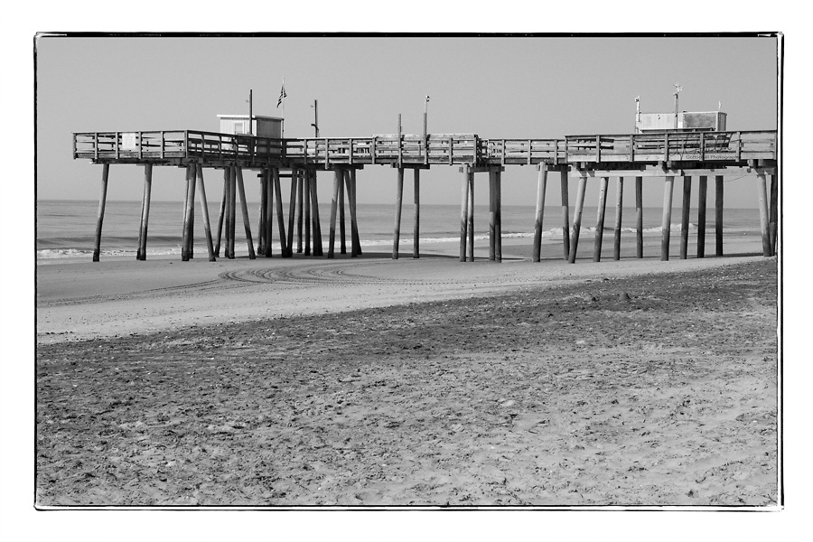 Black and white photography of The Margate Fishing pier in Margate, City, NJ is now on dry land due to the Dune project. There is no water below so there will be no fishing.