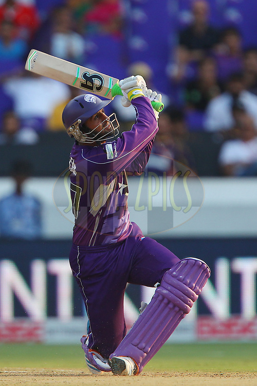 Shoaib MALIK of the Hobart Hurricanes launches a six during the first semi final match of the Oppo Champions League Twenty20 between the Kolkata Knight Riders and the Hobart Hurricanes held at the Rajiv Gandhi Cricket Stadium, Hyderabad, India on the 2nd October 2014<br /> <br /> Photo by:  Ron Gaunt / Sportzpics/ CLT20<br /> <br /> <br /> Image use is subject to the terms and conditions as laid out by the BCCI/ CLT20.  The terms and conditions can be downloaded here:<br /> <br /> http://sportzpics.photoshelter.com/gallery/CLT20-Image-Terms-and-Conditions-2014/G0000IfNJn535VPU/C0000QhhKadWcjYs
