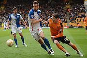 Blackburn Rovers defender Shane Duffy and Wolverhampton Wanderers striker Joe Mason battle for the ball 0-0 during the Sky Bet Championship match between Wolverhampton Wanderers and Blackburn Rovers at Molineux, Wolverhampton, England on 9 April 2016. Photo by Alan Franklin.