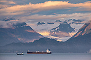 A storm clouds part at sunset over Grewingk Glacier on Kachemak Bay in Homer, Alaska.