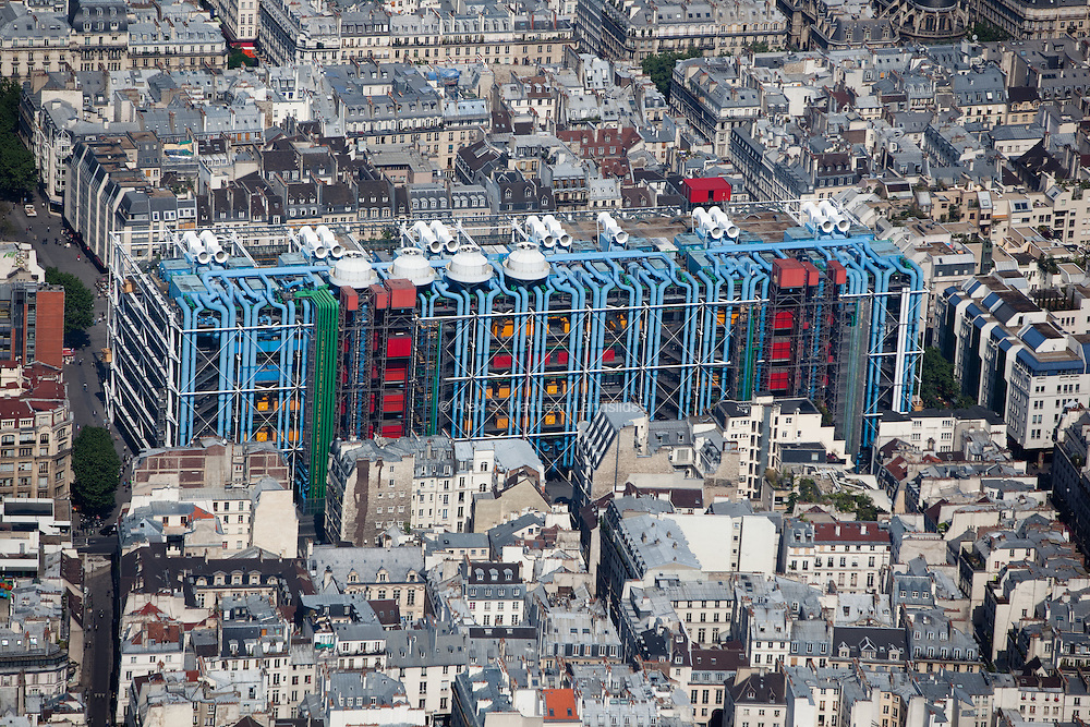 The Centre Georges Pompidou is a complex that houses a public library, the Musee National d'Art Moderne and IRCAM (a center for music and acoustic research). It was designed by the architectural team of Richard Rogers and Renzo Piano.