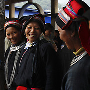 Dao women at the Tam Son market in Ha Giang, Vietnam's northernmost province, 24 June, 2007. As cities like Hanoi and Ho Chi Minh roar with Vietnam's economic boom, Ha Giang remains a quiet, serene and beautiful mountain backwater along the Chinese border.