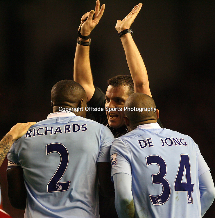 25/01/2012 - Carling Cup Semi-Final (1st Leg) - Liverpool vs. Manchester City - Referee Phil Dowd signals to Micah Richards of Man City that he raised his arms to block the ball - Photo: Simon Stacpoole / Offside.