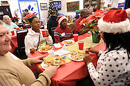 LEVITTOWN, PA -  DECEMBER 15:  From left, Wayne Watson, Precious Are, 11, Michael Are, 12 and Bami Watson chat at the table during a holiday dinner for former homeless veterans hosted by the Jewish War Veterans of America - Bristol and partnered with the Levittown Disabled American Veterans - Post 117 December 15, 2013 in Levittown, Pennsylvania. (Photo by William Thomas Cain/Cain Images)
