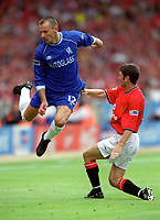 Mario Stanic (Chelsea) jumps the challenge from Denis Irwin (Man Utd). Chelsea v Manchester United. FA Charity Shield. Wembley 13/8/00. Credit: Colorsport.