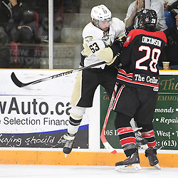 TRENTON, ON - Apr 22, 2016 -  Ontario Junior Hockey League game action between the against the Trenton Golden Hawks and the Georgetown Raiders. Game 5 of the Buckland Cup Championship Series, at the Duncan Memorial Gardens in Trenton, Ontario. Josh Allan #53 of the Trenton Golden Hawks takes the hit from Josh Dickinson #28 of the Georgetown Raiders during the second period.<br /> (Photo by Andy Corneau / OJHL Images)