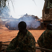 April 24, 2012 - Lalop, South Sudan: A group of SPLA soldiers look at the prepararion of war tanks at the newly established military base in the village o Lalop, 50 kilometers north of Bentiu...South Sudan and their northern neighbors, Sudan, have in the past two weeks been involved in heavily clashes over border disputes. Bentiu and neighboring villages have been under constant bombardment by the troops os Karthoum , who established their positions around 10 kilometers into South Sudan's territory. The international community is concerned about the possibility of a full on war between the two countries. (Paulo Nunes dos Santos/Polaris)
