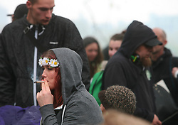 Hyde Park, London, 20/04/2014<br /> A girl smokes a spliff during a pro-cannabis rally in Hyde Park, central London. <br /> Photo: Anna Branthwaite/LNP