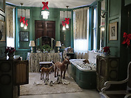 Old Westbury, New York, USA. December 17, 2017. A deer family and penguins watch over a fawn taking a bubble bath in Mrs. Phipps's bathroom at Westbury House at Old Westbury Gardens, a Long Island Gold Coast estate.