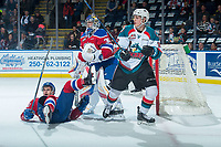 KELOWNA, CANADA - FEBRUARY 17:  Matthew Robertson #22 falls to the ice in front of Todd Scott #35 of the Edmonton Oil Kings after being checked by Jack Cowell #8 of the Kelowna Rockets on February 17, 2018 at Prospera Place in Kelowna, British Columbia, Canada.  (Photo by Marissa Baecker/Shoot the Breeze)  *** Local Caption ***