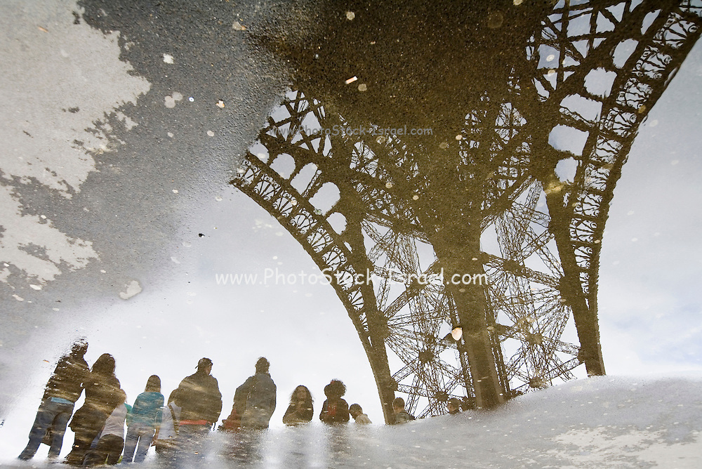 France, Paris reflection of the Eiffel tower in a water puddle