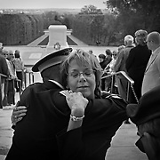 KerrieAnn Mayes-Skuran (cq) hugs Rob Cowan (cq) while Maj. (Ret.) Thomas J. Cowan (cq) is at right after they presented a wreath at the Tomb of the Unknown Soldier in honor of Sumner L. Cowan at Arlington National Cemetery on Friday, April 9, 2010. Sumner Cowan, 27, committed suicide after returning from serving in Iraq. Mayes-Skuran is his mother, Thomas Cowan is his father, and Rob Cowan is his cousin. In 2004, the three Cowans participated in the same ceremony together while all were active duty military. On Friday, Mayes-Skuran took the place of her son as they repeated the honor.<br /> <br /> (Brian Cassella/ Chicago Tribune) B58374631Z.1<br /> ....OUTSIDE TRIBUNE CO.- NO MAGS,  NO SALES, NO INTERNET, NO TV, NEW YORK TIMES OUT, CHICAGO OUT, NO DIGITAL MANIPULATION...