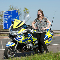 STV Reporter Louise Cowie and police motorcycle on the M90 motorway<br /> Picture by Graeme Hart.<br /> Copyright Perthshire Picture Agency<br /> Tel: 01738 623350  Mobile: 07990 594431